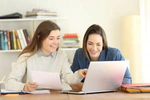 Two students researching college